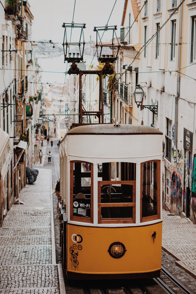 the tram in the city of lisbon, lisbon in portugal, european cities to enjoy the beach and city