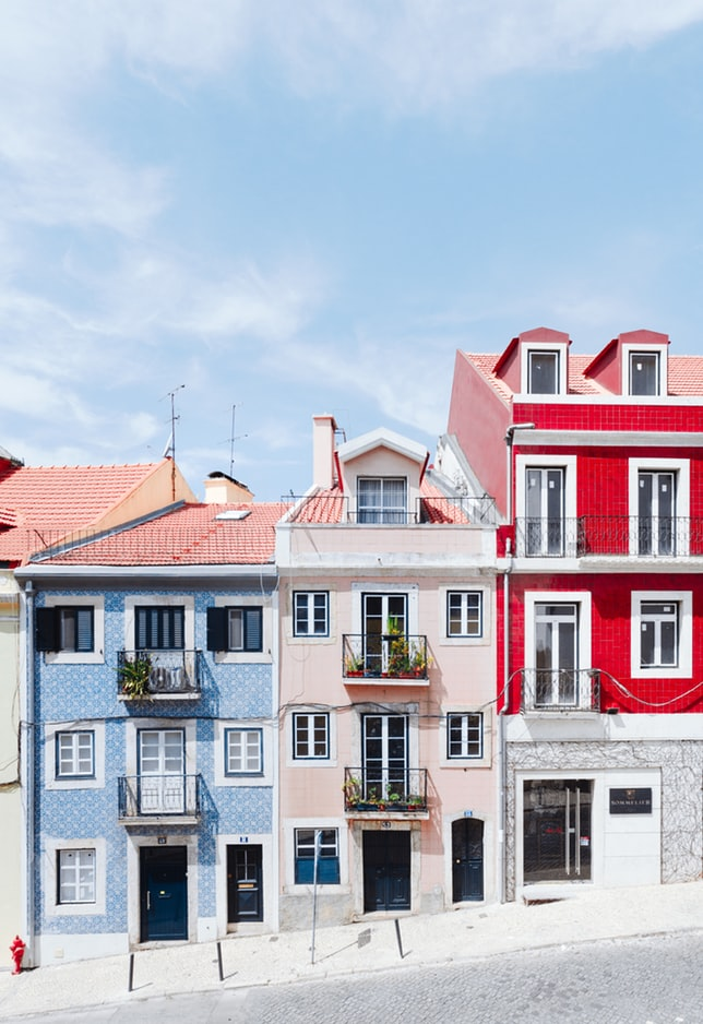 colorful houses in the street of lisbon, red houses, blue houses, lisbon city in portugal