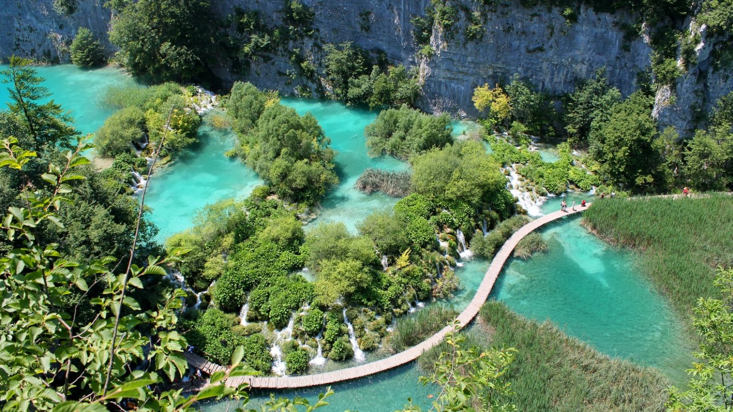 the amazing plitvice lakes in croatia to visit, incredible blue water with green nature, dream destinations to visit in europe