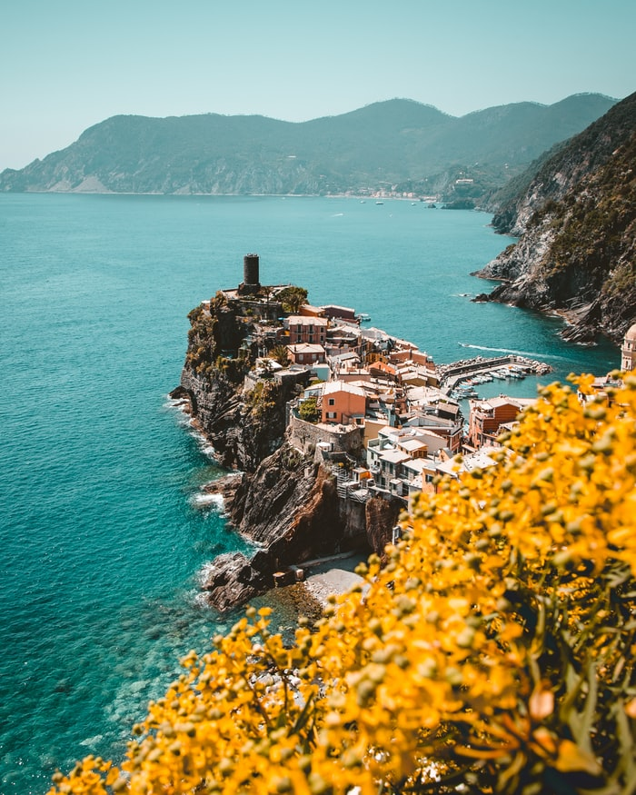 amazing dream destinations to visit in europe, cinque terre in italy, view over the ocean, mountains in the background