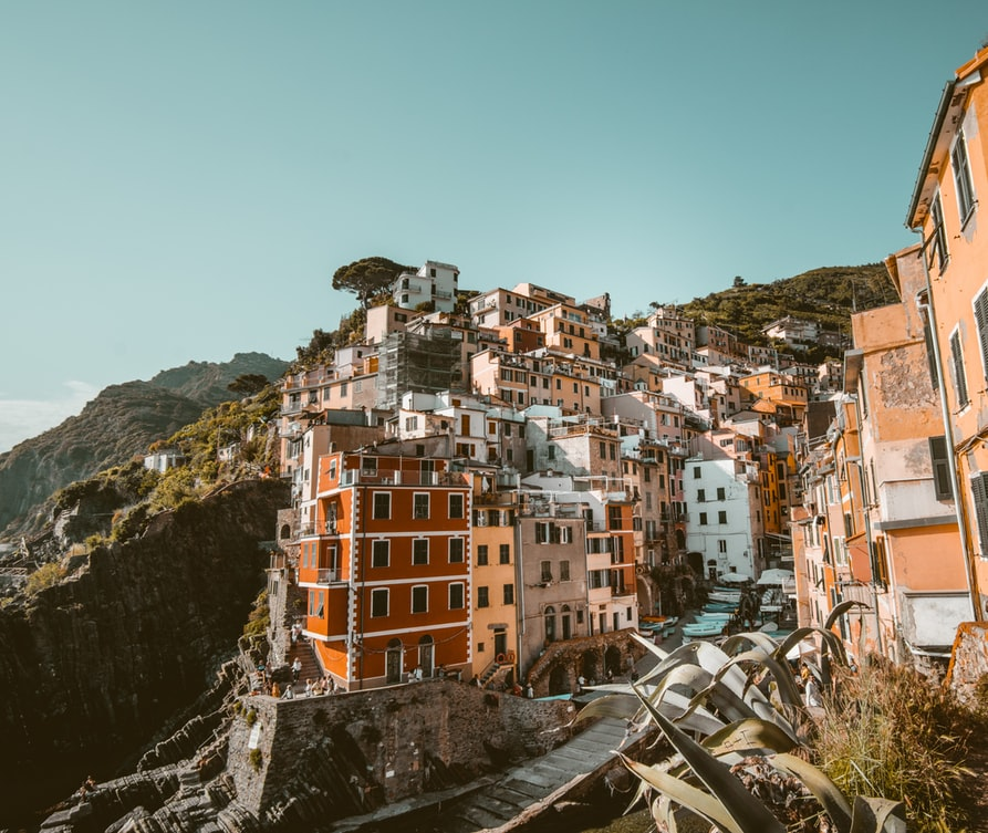 dream destinations in europe to visit next, cinque terre in italy, houses on mountain and blue sky