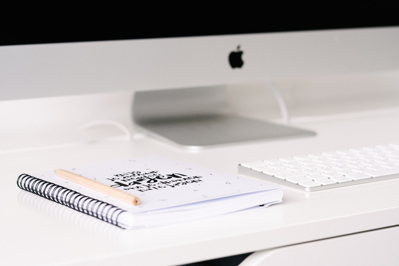 how to increase productivity at home, imac with planner and keyboard