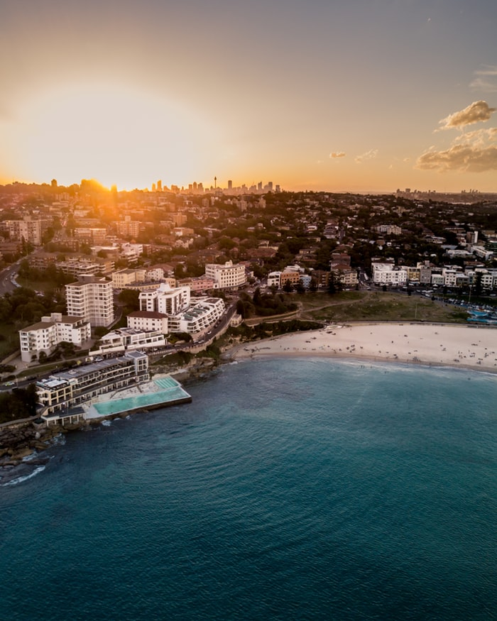 bondi beach, iceberg, beach and the ocean during sunset, view over the city sydney in australia