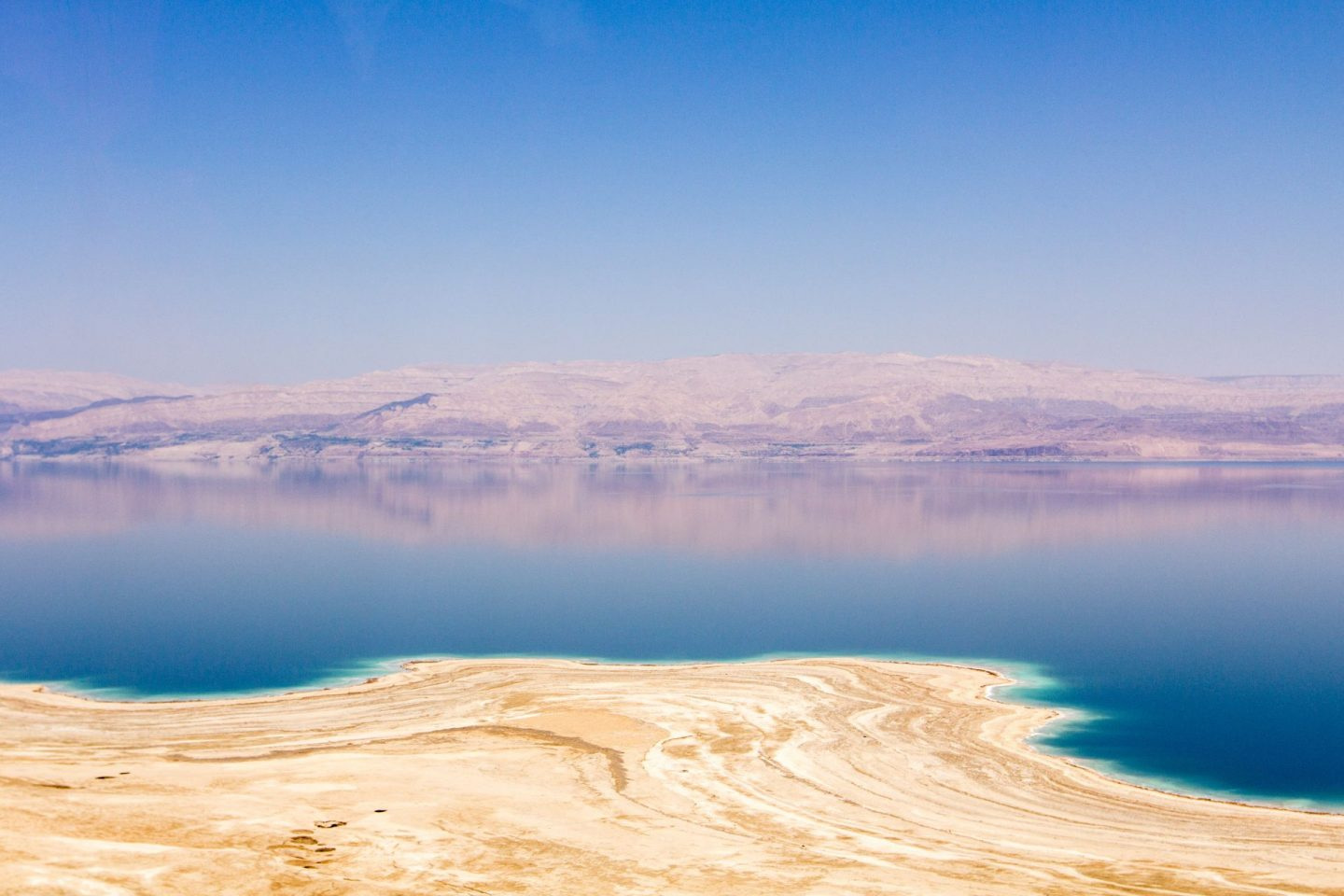 view over the dead sea in israel, lake with mountains in background, purple tones, 20 destinations to visit in 2020