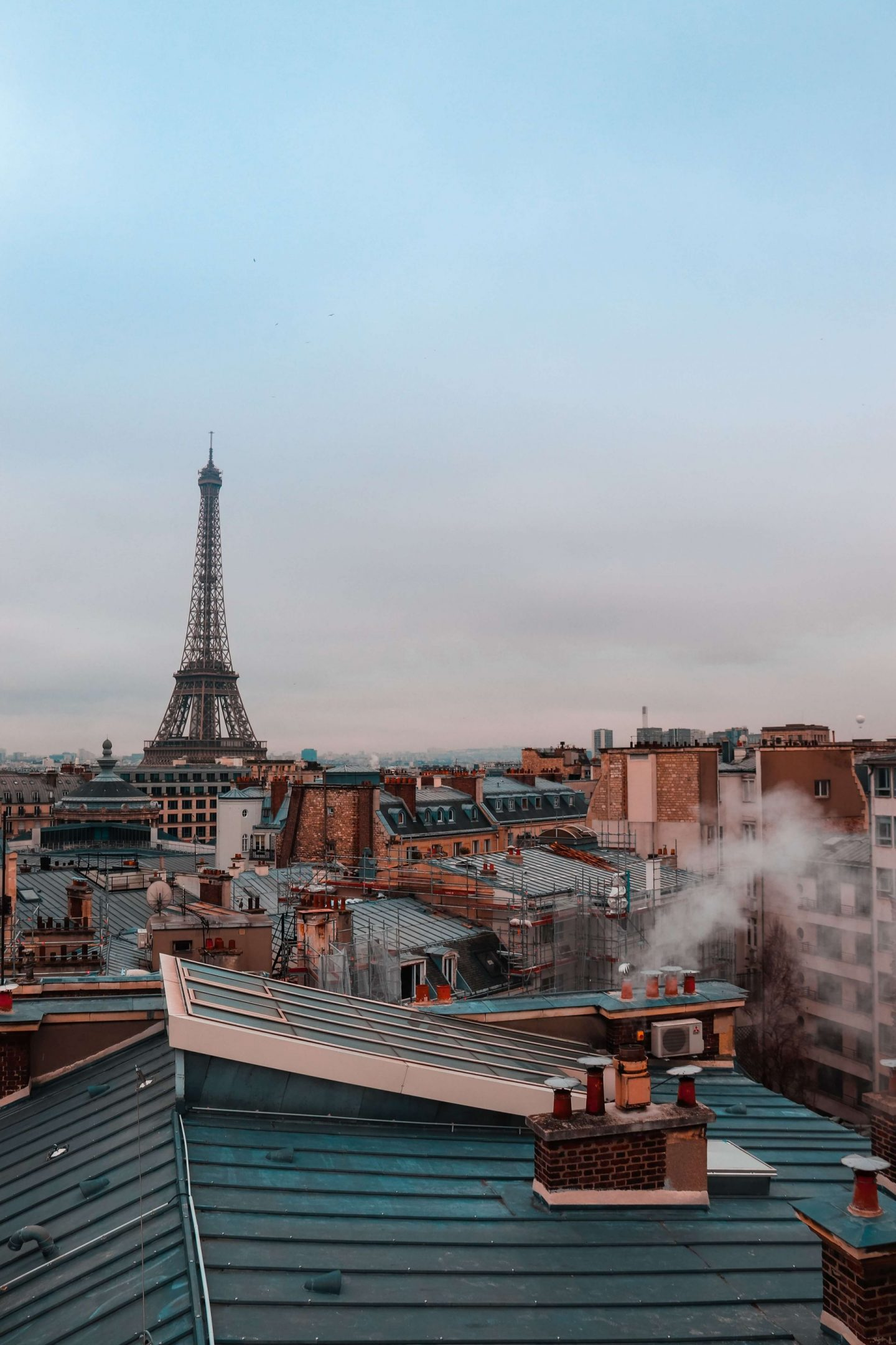 things to do in paris, bucket list experiences, city in france, view over houses to the eiffel tower, sunset