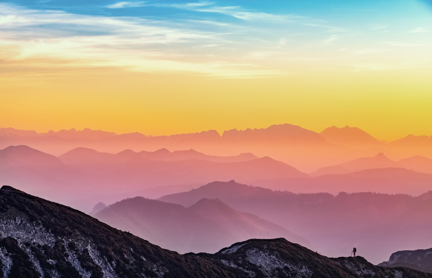 sunset or sunrise above the mountains, sustainable travel, eco friendly, responsible travel, 8 tips on how to choose an eco-friendly hotel, where to go, where to stay, tips, travel tips