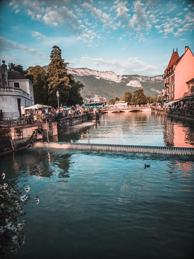 view from the river over the village annecy in france, fairy tale places