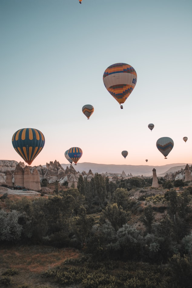 cappadocia in turkey, hot air balloons in the sky during sunset