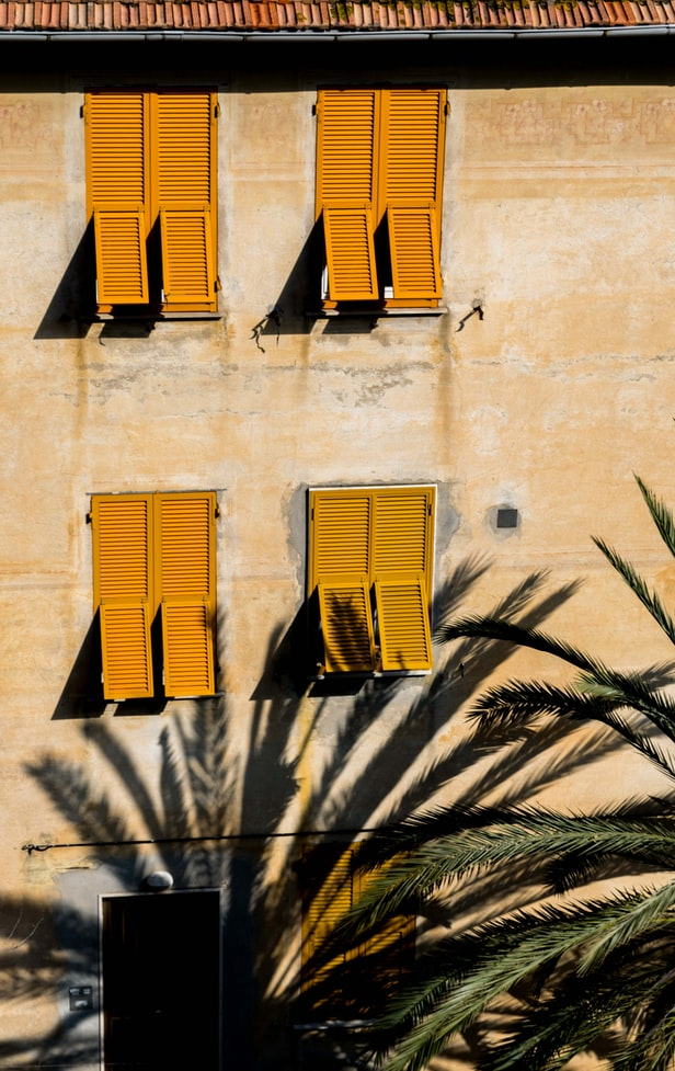 cinque terre italy, yellow house with yellow windows