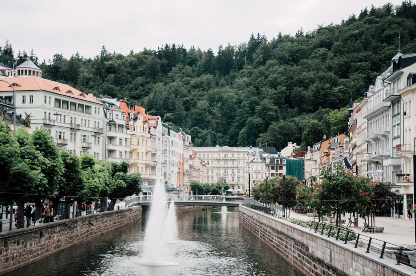 Karlovy Vary in the Czech Republic, white and pastel colored houses near a river