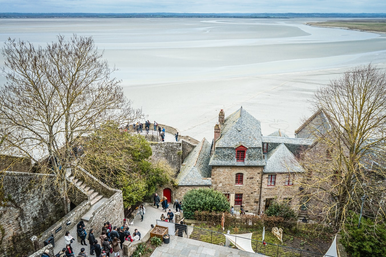 the normandy region in france, mont saint michel castle, fairy tale villages to visit