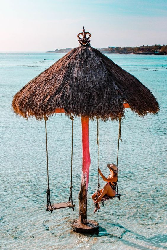a swing in the ocean in bali indonesia, bali travel photography and travel inspiration