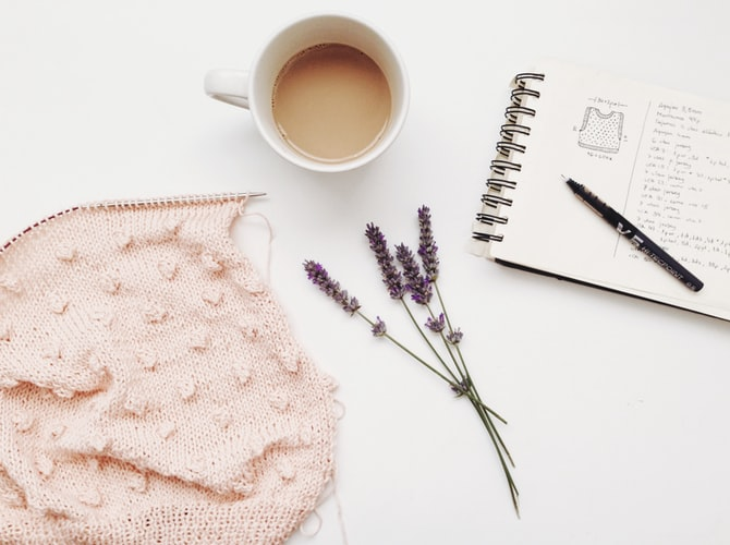 a notebook with a pen and coffee, the truth behind blogging and tips before you start a blog