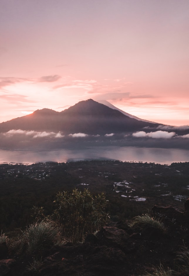 the volcano and mount bature in the background during sunset, travel photography, bali, indonesia