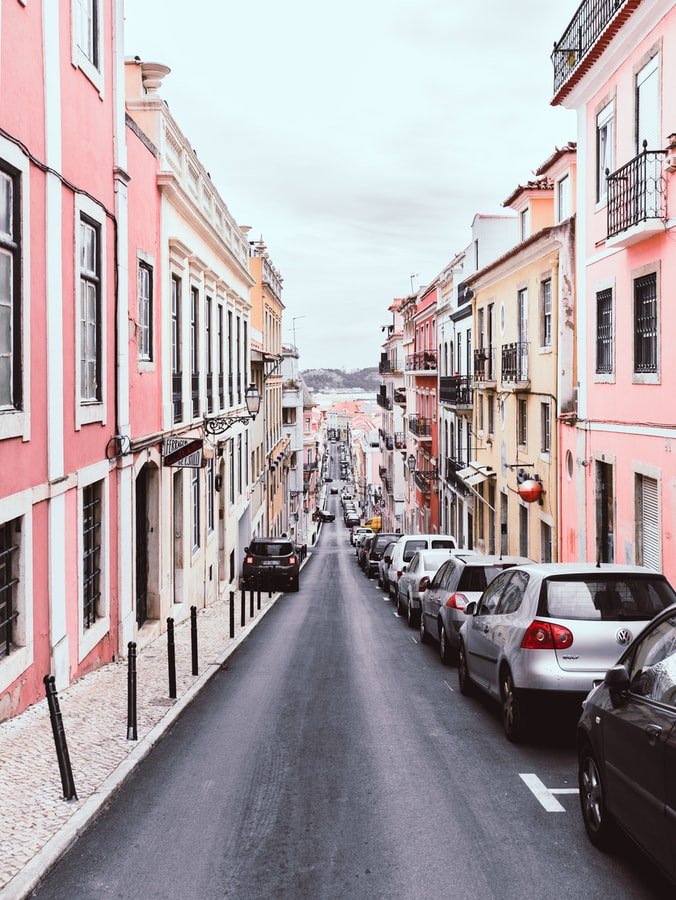 pastel colored streets in lisbon, travel in portugal, budget travel