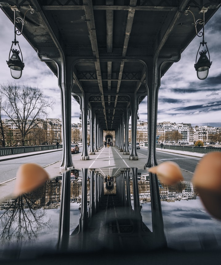 driving under a bridge in paris, france travel, perfect paris quotes and instagram captions