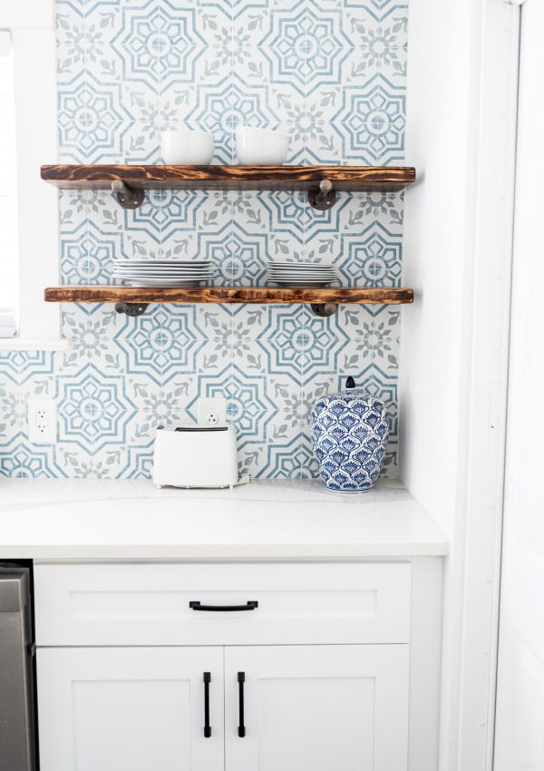a kitchen with blue tile, wooden shelves and blue details, the kitchen design, building and movies series