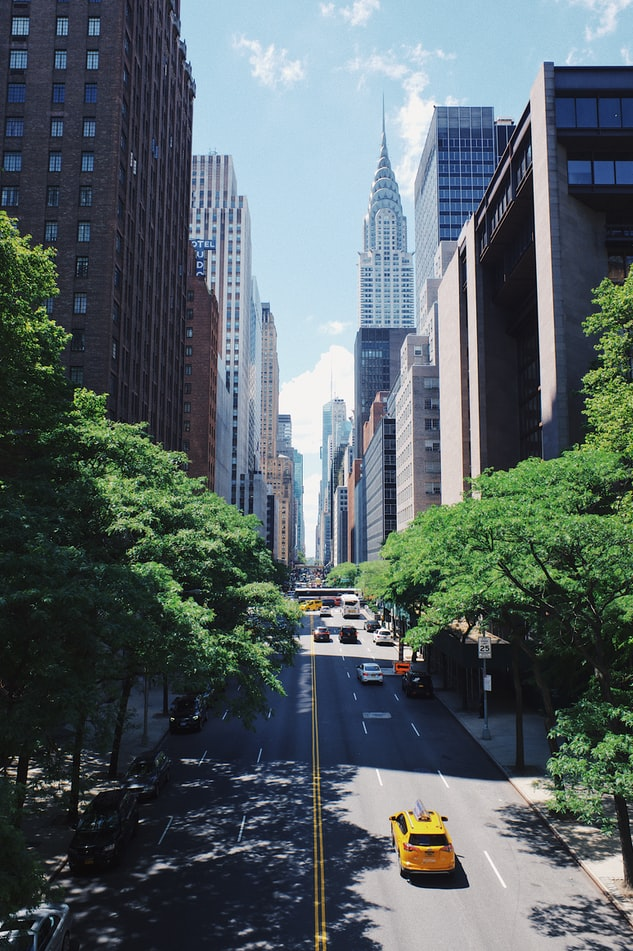 green street in new york city, skycrapers in the background