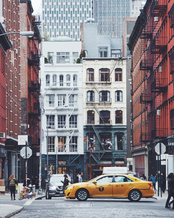 new york city street, yellow cab in the city, buildings