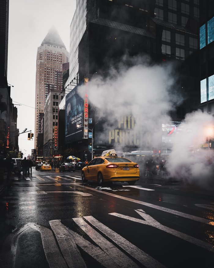 a moody day in new york city, yellow cab in the streets of new york city