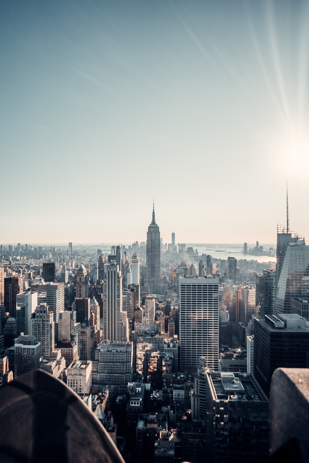 a view over new york city from the rooftop during a sunny day
