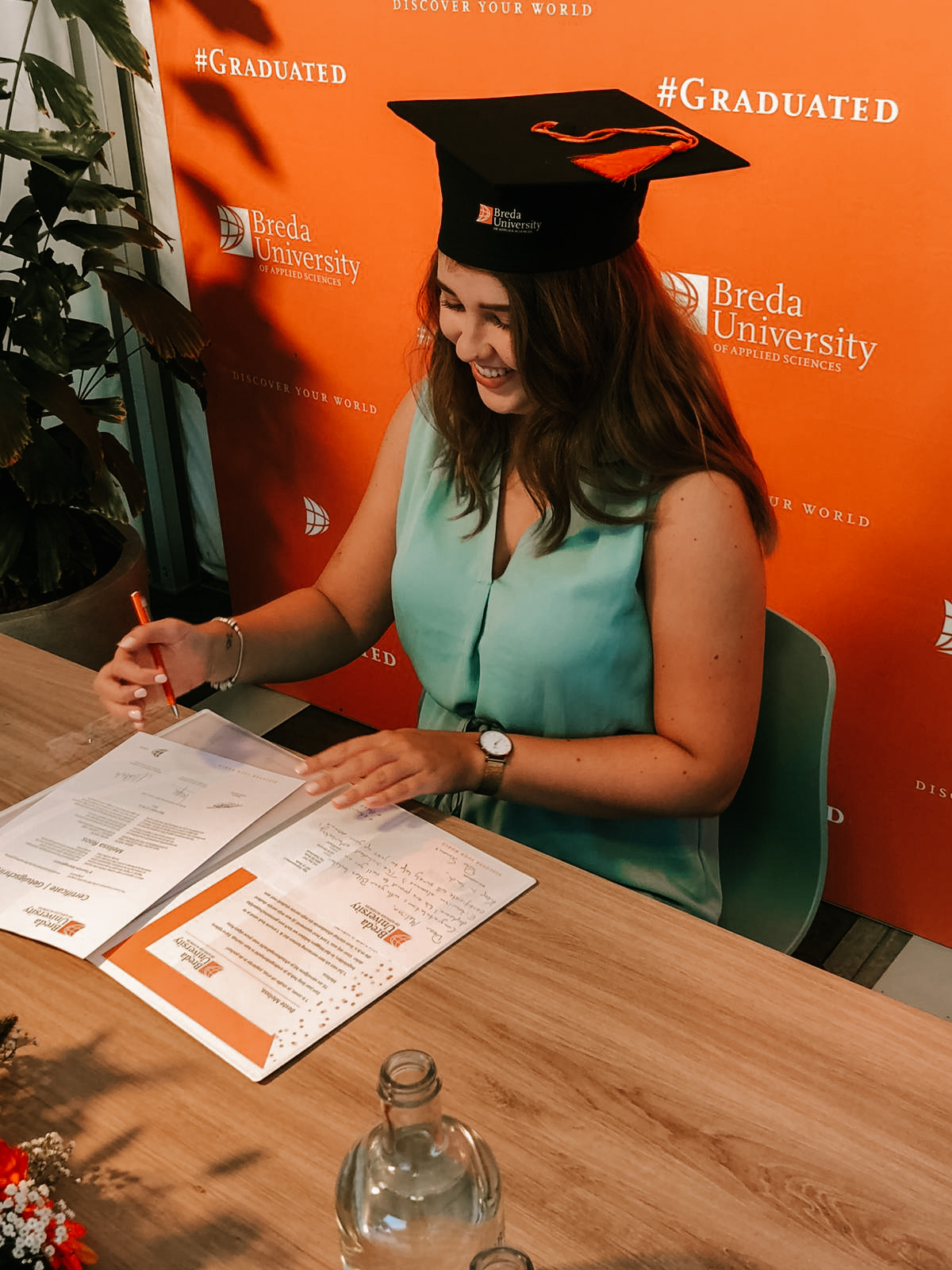 signing my degree on the diploma, graduation ceremony
