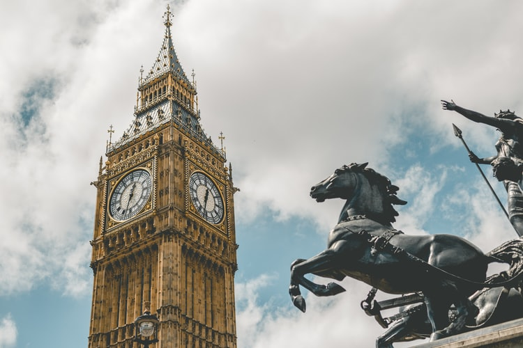 the big ben with a blue sky and clouds including a statue of a horse, london quotes