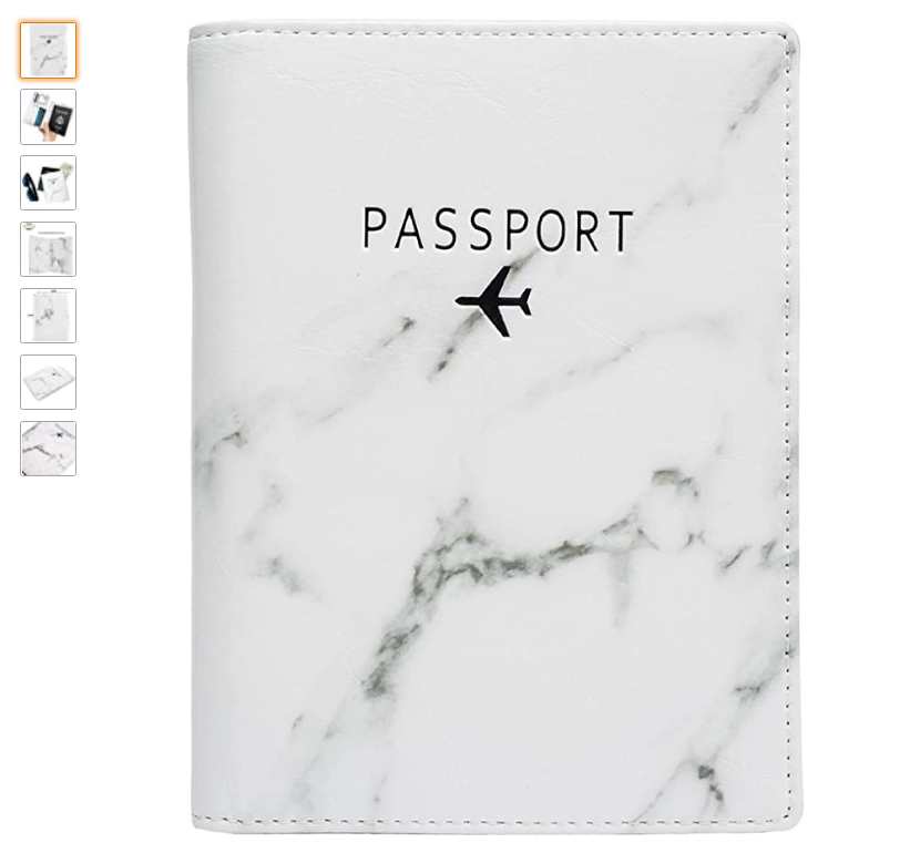 a marble looking passport holder and passport case with an airplane