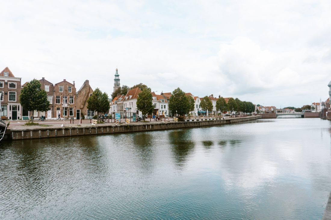 a view over middelburg from a canal, town houses, canal in middelburg, trip to middelburg