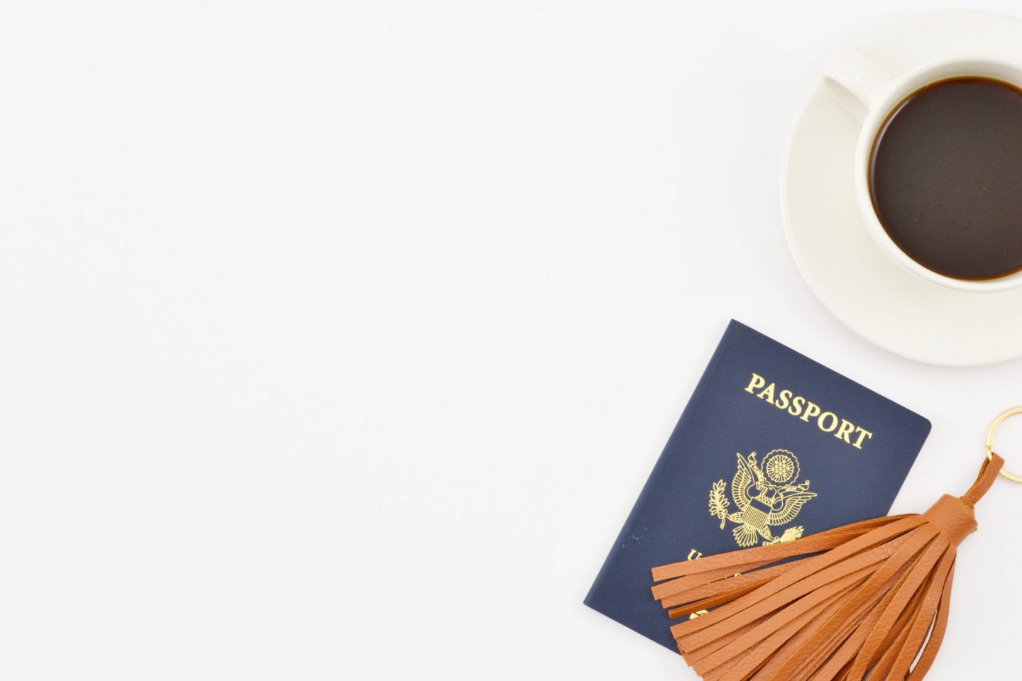 a passport with coffee flat lay photo, travel mistakes to avoid, travel documents