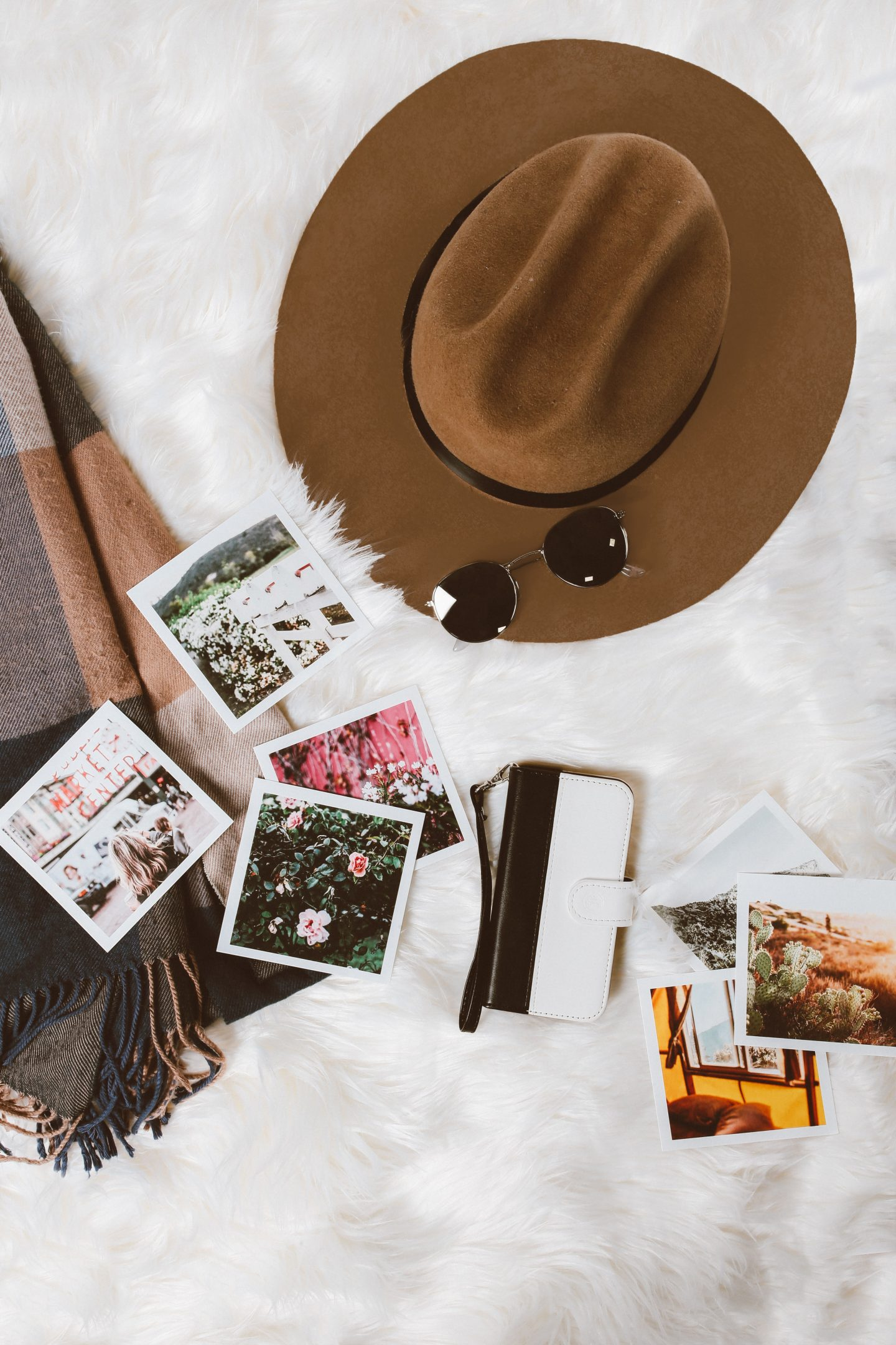 polaroid camera with polaroid pictures, a hat and a bag, travel secrets