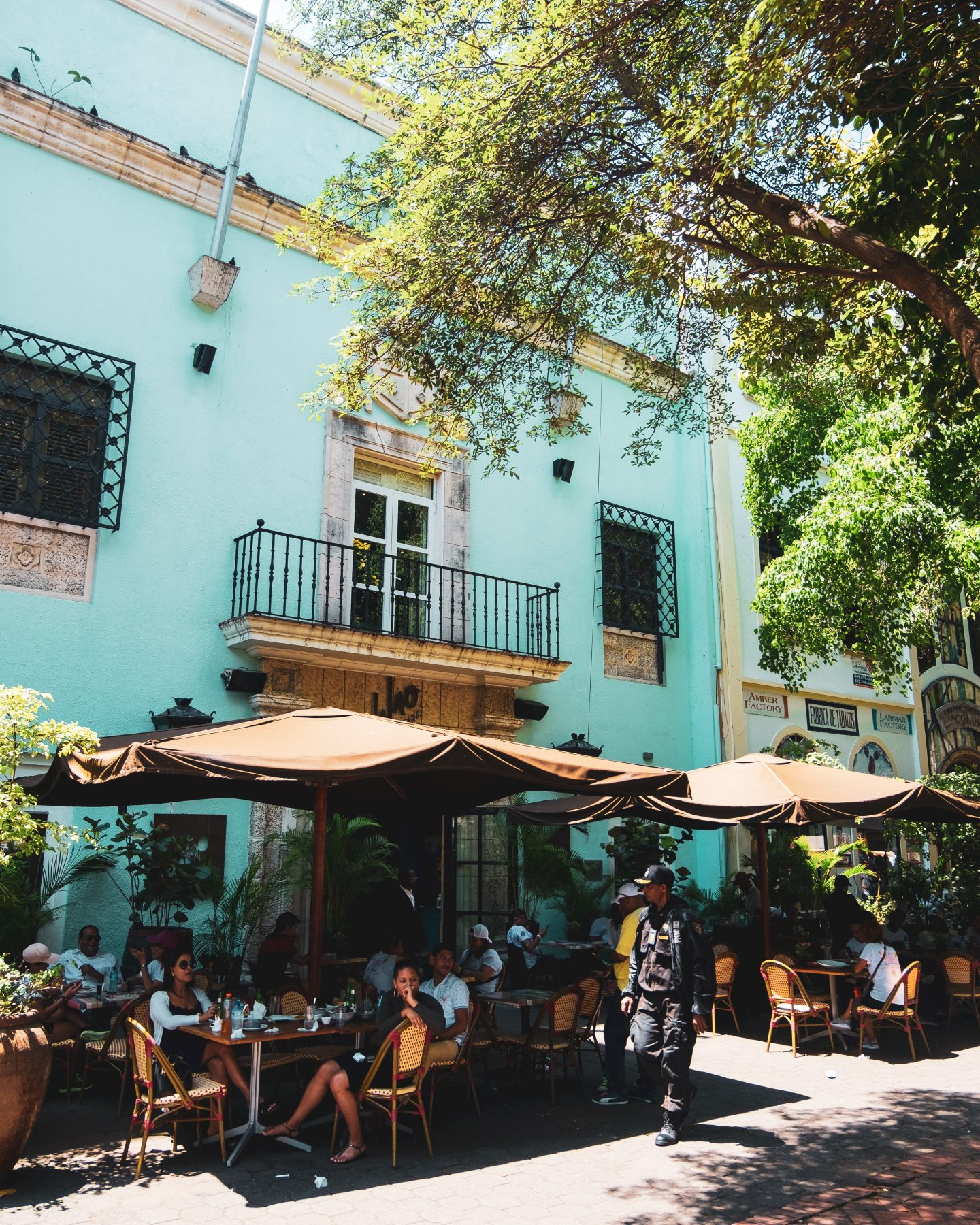 a colorful restaurant with a terrace, blue walls and trees, travel mistakes to avoid