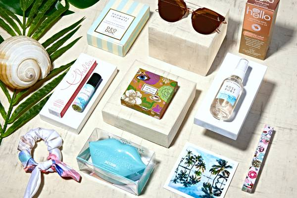 the wanderlust subscription box with bikinis and other beach essentials