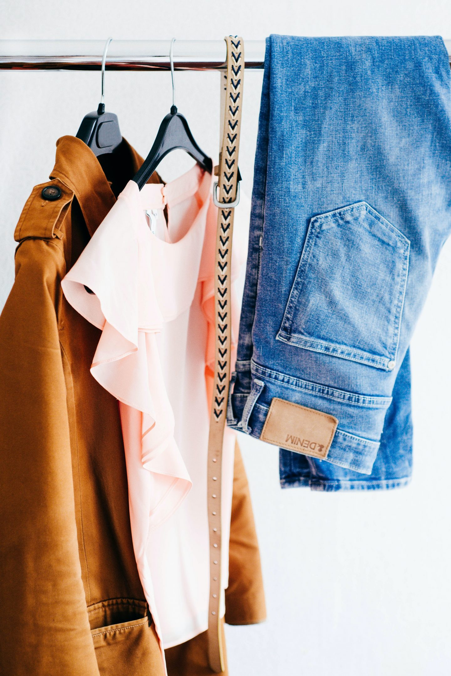 creating new outfits with vintage cothes, brown jacket, white shirt, gold belt and blue jeans