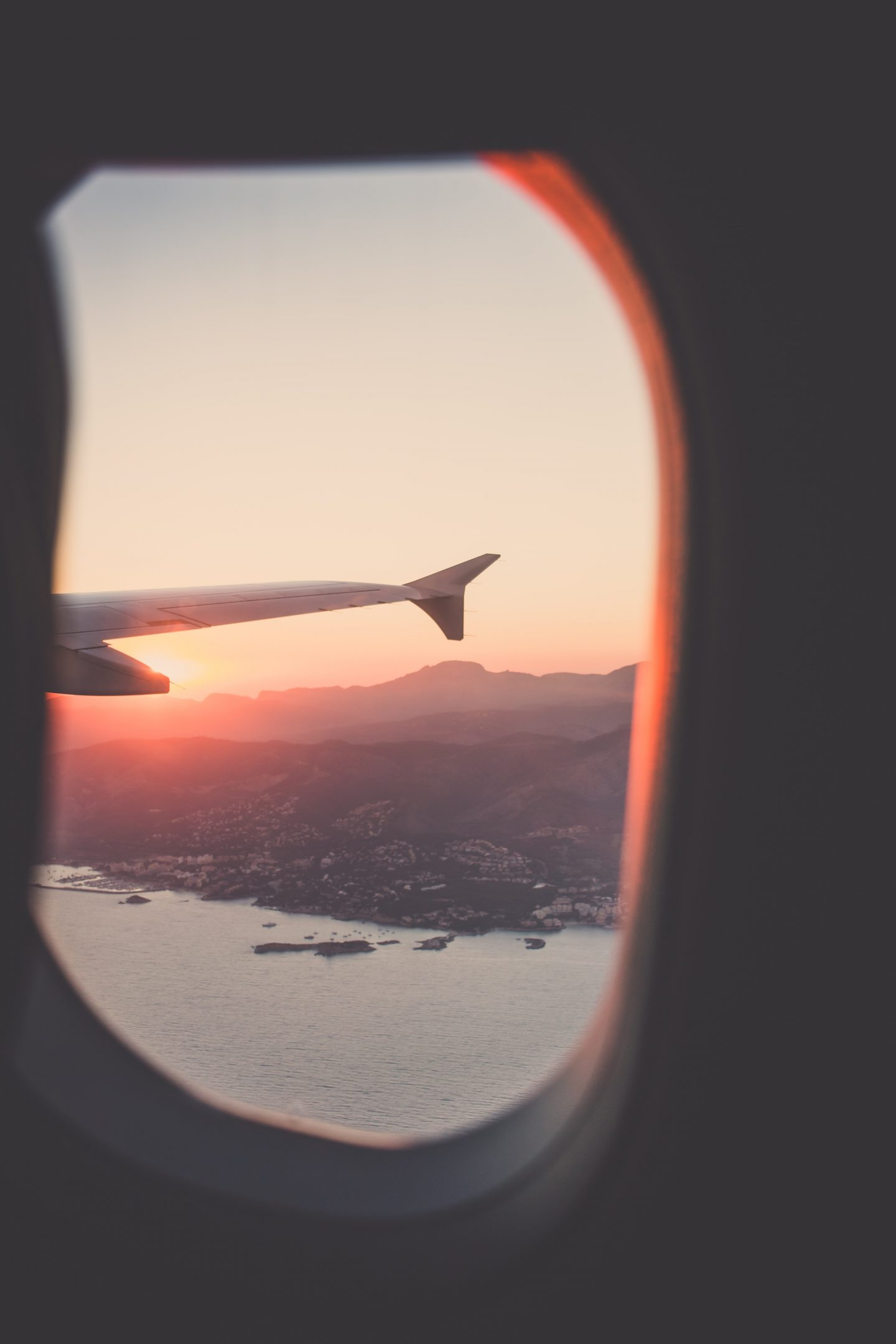 a view from the airplane over mountains, ocean view, mountain view, luxury travel