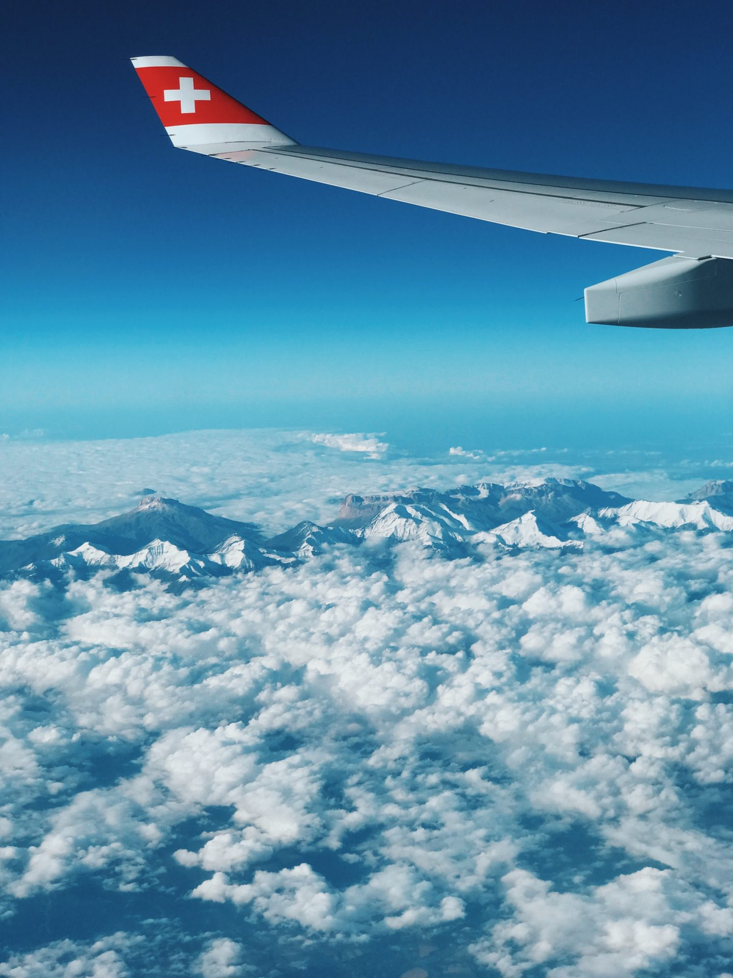 view over clouds and mountain from the mountain, airplane view, tips to get upgraded