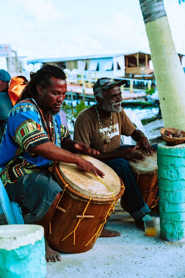 two man playing music on the street, colorful, cultures