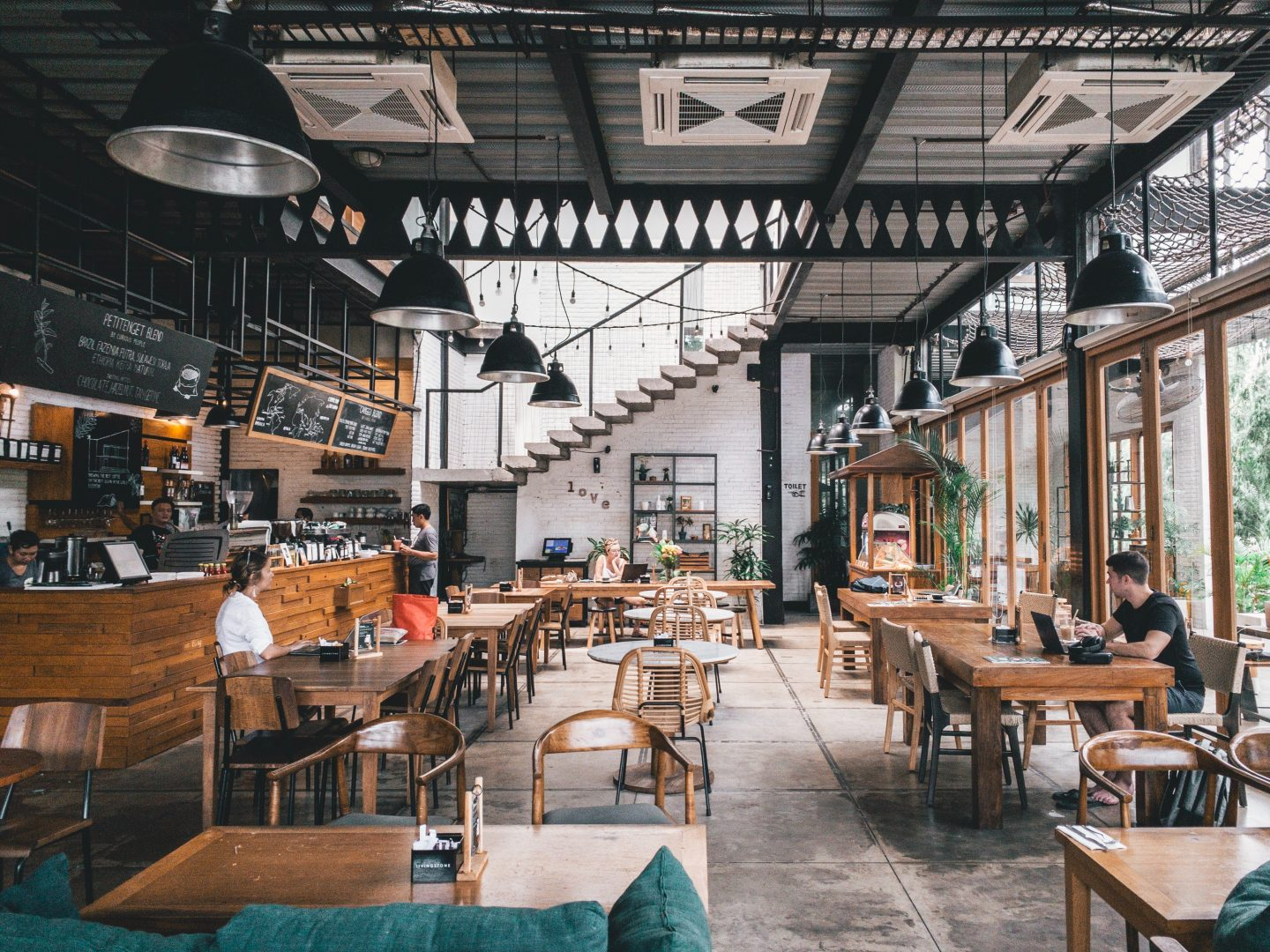 the inside of a restaurant, industrial interior, vegan and vegeterian restaurants while travelling