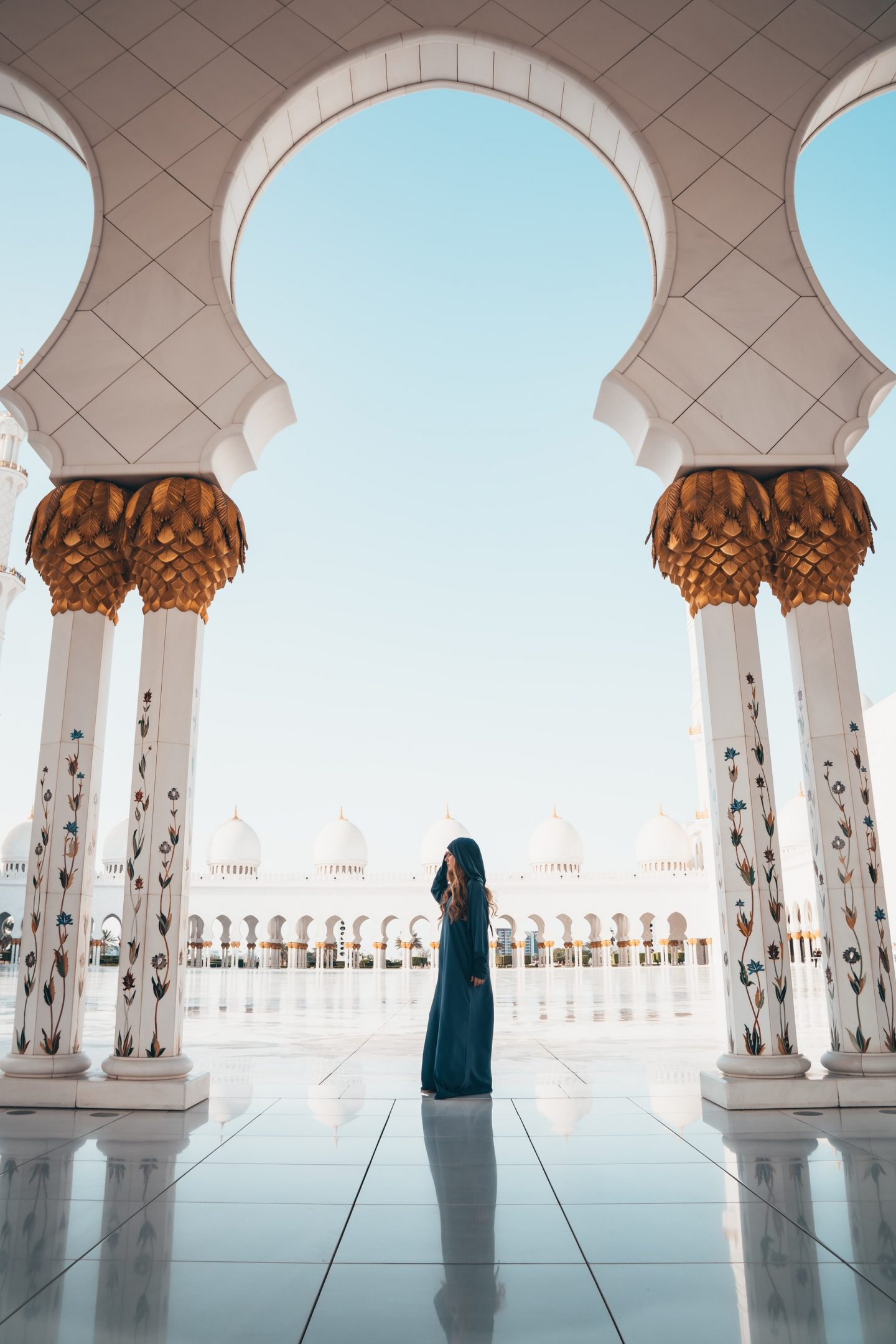 girl in a mosque, pillars, photography, architectual photography