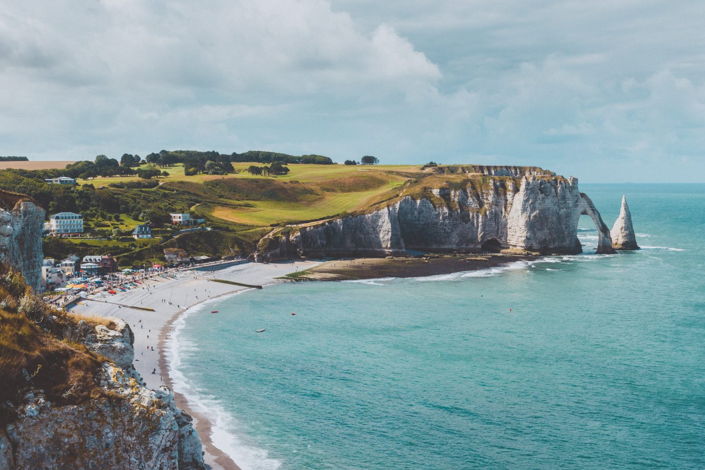 a view over the ocean and cliff in etretat in france, france travel, europe travel