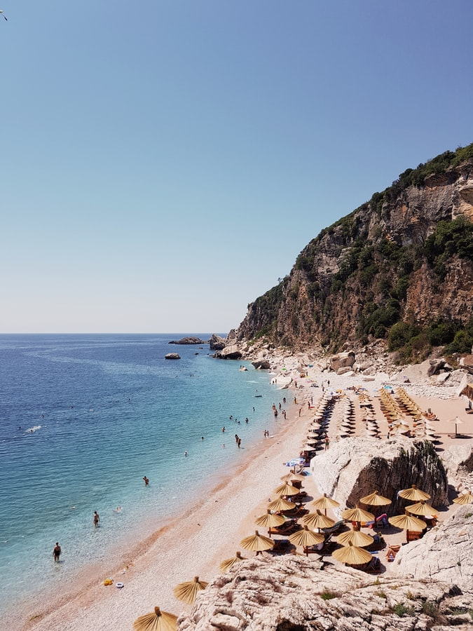 view over a beach, cliff and ocean in montenegro, montenegro travel