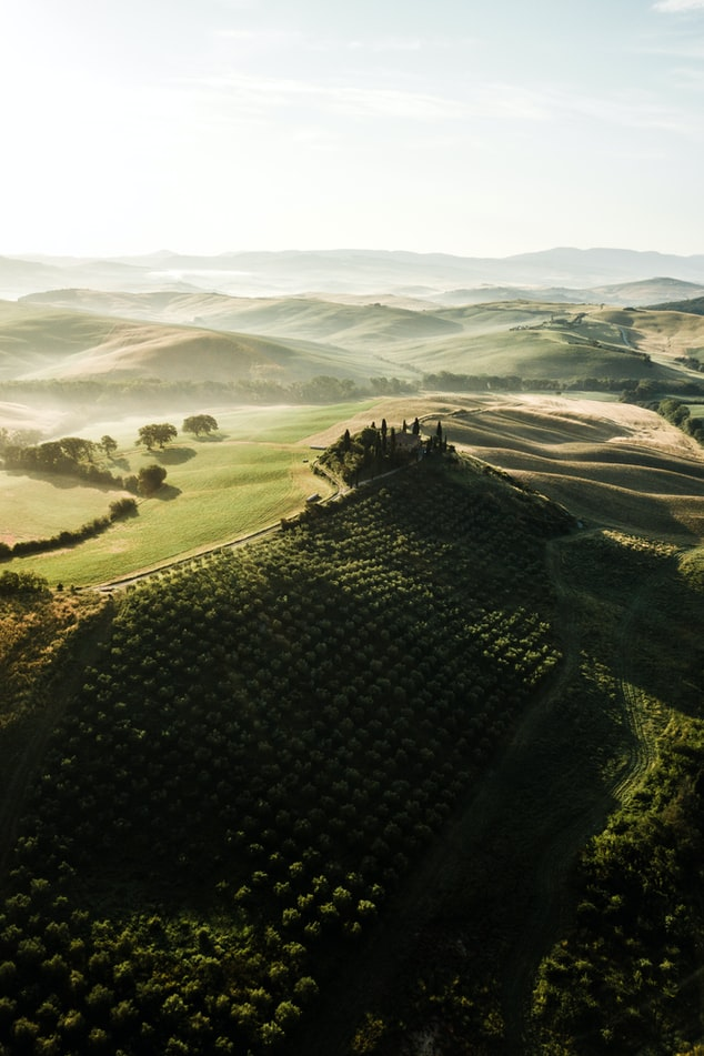 a view over tuscany, green mountains with sunrise