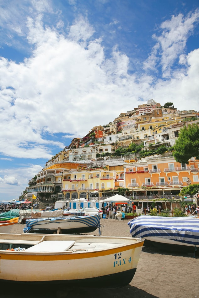 view over positano, colorful houses, boats on the beach