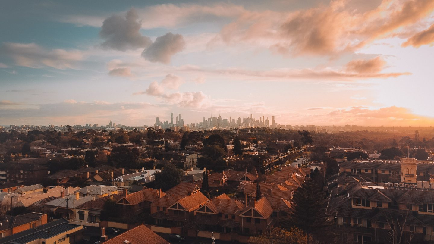 a view over the skyline in melbourne during sunset, skyline photography, succesful staycation