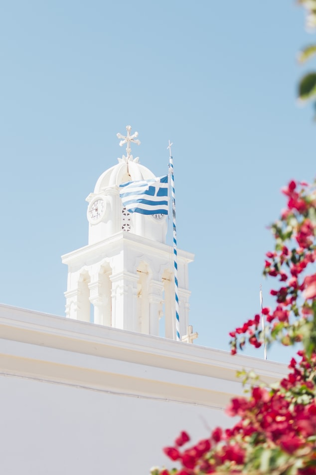 white washed building in santorini, travel in greece, spring travel in greece