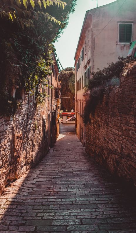an italian looking street to discover if you travel responsible, village street during the sunset